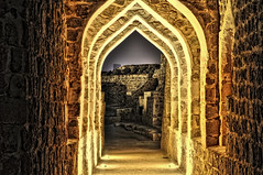 A Passage To The Ancient City ( Hussain Frutan | www.hf-photos.net) Tags: lighting old sea sky reflection set night landscape photography bahrain amazing ancient nikon rocks view shot photos muscle smokey land 18 55 scape hdr manama arad bahrian hussain hf  hidd fozool cloued   muharaq d5000   banosh maharaq cloueded ma7araq frutan wwwhfphotoscom