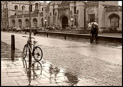 Rain in Cambridge: King's College (Sir Cam) Tags: cambridge england blackandwhite bw rain bicycle umbrella university kingscollege photooftheday kingsparade peopleschoice aplusphoto 6jul2007