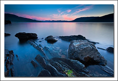 Lake Pend Oreille Sunset (Chip Phillips) Tags: pink blue sunset sky lake green water rock horizontal landscape photography bay colorful phillips north calm idaho chip glowing canon5d fa oreille pend naturesfinest canon1740 diamondclassphotographer ostrellina