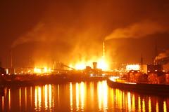 Steel industry on fire (jepoirrier) Tags: chimney sky reflection industry clouds river fire belgium belgique steel smoke belgië blaze meuse liège wallonie arcelor seraing mittal