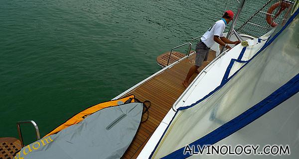 Our skipper Yudas, unloading the kayak