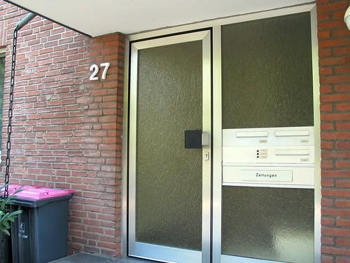 Entrance to the Apartment Building by crbassett