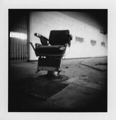 Have a seat 2 (Otto K.) Tags: atlanta light bw abandoned window polaroid blackwhite holga chair pipe cell center prison jail holgaroid deserted decayed pretrial barberchair detention ottok