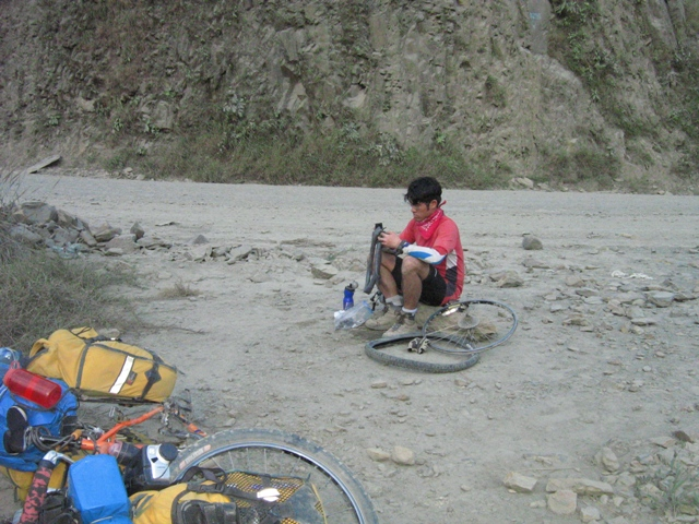 Fixing a pinch flat in the middle of the road in the Yungas.