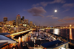 Moon Rising over the Seattle Waterfront (David M Hogan) Tags: seattle longexposure moon night washington bravo cityscape waterfront refelection themoulinrouge pier66 davidhogan cted08lic