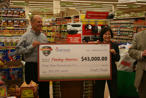 At a recent Hunger Action Month event, Lisa Mann of Kraft Foods presented Doug Montgomery of Feeding America with a check for $43,000 to help purchase food and meals for hungry Americans.