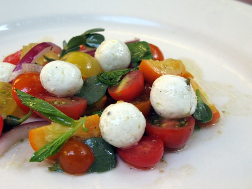 Tomato and kumquat salad with mint, purslane, red onion and goat cheese (labneh)