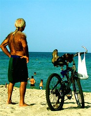 Ancient Sentry (vicequeenmaria) Tags: ocean old hairy man beach bicycle back sand ponytail miamibeach bathingsuit greyhair hoary