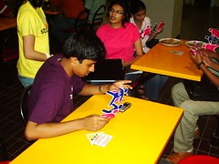Engrossed in the flyer (yah.sg) Tags: nus yah aidsawareness stompaids stompaidschallenge stompaidschallenge2007 stompaids2007