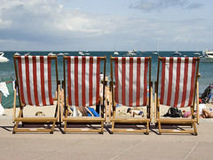 Sunbathing (Stringendo) Tags: red beach four warm stripes empty dorset swanage deckchairs purbeck novideo