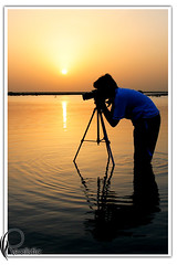 Sunset Photographer (Realistic Qatar) Tags: camera sunset sea sun water silhouette sunrise al photographer shot tripod super  orang doh doha qatar realistic  alwakra    wakrah  supershot  wakra    alwakrah      aldoha anawesomeshot