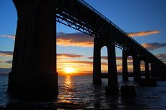 Colourful Sunset of the Tay Rail Bridge (Ross2085) Tags: uk bridge blue sun history beach water beautiful sunshine metal train river coast scotland nikon mood arch colours view fife dundee dusk ripple steel horizon rail sunny awsome tay newport stunning fade impressive girders gentle supports wormit d40 theunforgettablepictures