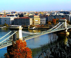 Budapest - Autumn on the Chain bridge (jackfre2-Fllickr connections get worse everyday!!!) Tags: bridge autumn trees fall cars buildings liberty hungary budapest tram arches tramway danube buda palaces pest donau chainbridge szechenyilanchid