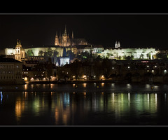 Reflections on Vltava (Barry_Madden) Tags: city longexposure autumn reflection castle fall church water night buildings reflections river lights evening cityscape prague cathedral praha nightphoto vltava oldcity weir 2010