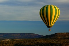 Floating Over Sedona (Scott Ableman) Tags: morning arizona green topf25 yellow sunrise d50 stripes balloon sedona fv5 explore hotairballoon fv10 striped sedonaarizona northernlight 18200mmf3556gvr interestingness362 interestingness309 i500 superphotographer explore06jul07 anawesomeshot superbmasterpiece northernlightballoonexpeditions bachspicsgallery 2009challenge 2009challenge319
