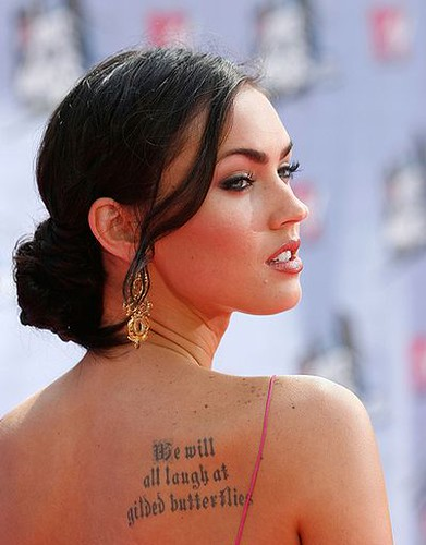 Her tattoos total of seven as of now include a poem on her ribcage, a symbol