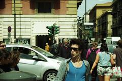 ... (icomewhenieatcaponata) Tags: italien boy italy color film girl analog 35mm canon eos lights italia traffic kodak iso 200 semaforo sicily plus 300 palermo whistle sicilia rayban   sizilien   colorplus       peppopeppo  puddicinu icomewhenieatcaponata