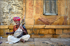 The Sarangi Player (Saptak Ganguly) Tags: people music india nikon trance jaisalmer rajasthan d90 sarangi sarangiplayer