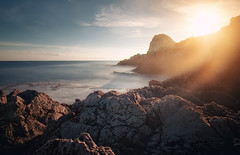 Frozen In Time II (Philipp Klinger Photography) Tags: trip morning italien light sea vacation sky italy cloud sun holiday cold water rock clouds sunrise frozen nikon rocks warm medi