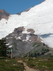 A hiker admires Mt Baker from the Park Butte Lookout trail
