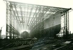 Mauretania Construction (Tyne & Wear Archives & Museums) Tags: building metal museum boat construction industrial ship arch crane timber steel board ships shed platform surreal vessel tyne pole pile worker unusual shipyard 1906 northeast plank tyneside cunard immense glassroof pathway joint sections rn oceanliner shipbuilding tuberose royalnavy shipbuilders tyneandwear overwhelming hospitalship cunardline swanhunter mauretania troopship twam blackwhitephotos maritimeheritage swanhunterwighamrichardson rmsmauretania swanhunterandwighamrichardson tyneandweararchivesandmuseums rmsmauretania1906 hmhsmauretania hmstuberose