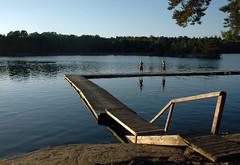 Still Summer (Joopey) Tags: bridge sea summer lake tree boys water nikon d70 sweden stockholm jetty schweden d70s scandinavia fishin sude hellasgrden