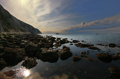 Rock pool - Alum bay, Isle of Wight (s0ulsurfing) Tags: ocean blue light shadow sea sky cliff cloud sun sunlight seascape seaweed reflection beach nature water beautiful sunshine weather rock clouds composition wow spectacular landscape boats island bay coast boat amazing fantastic sand bravo scenery rocks skies natural bright wind stones patterns wide perspective wideangle pebbles cliffs dreaming coastal isleofwight coastline lowtide framing isle impressive wight 2007 rockpools alumbay 10mm eow sigma1020 supershot spectacularlandscape s0ulsurfing thecloudappreciationsociety abigfave karmapotd superaplus aplusphoto goldenphotographer