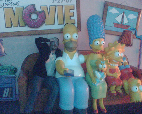 Mike on the couch with the Simpsons