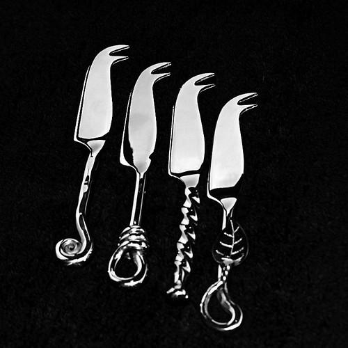 Cheeseknives on black