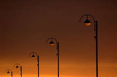 Posh street lights (~Glen B~) Tags: uk light sunset red england orange silhouette lights glow dusk cleveland lampost lamps teesside redcar bbok redbubble:id=1004331thefutureisbright