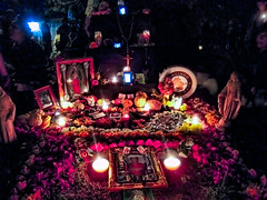 Day of the Dead Altar (Walker Dukes) Tags: sanfrancisco california flowers blue red black green yellow statue fruit lights candles madonna topaz giantsfan topazadjust
