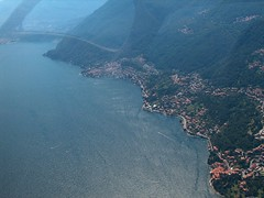 Lago di Como (_ Night Flier _) Tags: above city travel blue sky italy panorama lake rooftop nature water airplane landscape town flying high view earth top aviation aerial h2o fromabove coastline lombardia cessna skyview lagodicomo lombardy birdeye aeronautic