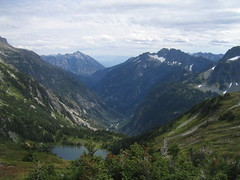 Doubtful Lake And Mountains (Ryan Hadley) Tags: trees cliff usa lake snow mountains nature clouds creek forest landscape washington nationalpark hiking meadow rockface valley cascades alpinelake tarn northcascades cascademountains northcascadesnationalpark cascadepass sahalearm sahalemountain doubtfullake peltoncreek sahalepeak bookermountain mcgregormountain glorymountain trappermountain