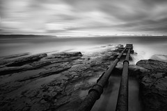 A Storm Is Approaching (Sam Ilić) Tags: ocean light sunset sky bw water clouds canon long exposure pipes australia baths wollongong bw110 canon1740mm4 5dmarkii