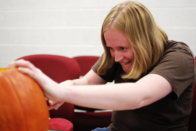 Sarah carving a pumpkin.