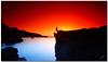red blue and silhouette (chris frick) Tags: sunset sea clouds rocks exposure dusk wideangle filter nd nophotoshop mallorca tobacco mediterraneansea cokin straightoutofthecamera gnd originalcolours modelmartina chrisfrick bensdavall sonyalpha550 redblueandsilhouette
