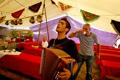 (Paulgi) Tags: music food man portugal kitchen canon book mar europe village wine tent 24mm pilgrims romeiros minho esposende bartolomeu paulgi sobartolomeudomar cachadinha romeiros~pilgrims