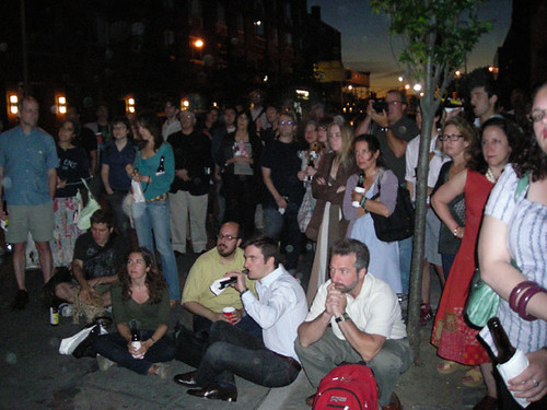 people outside watching slideshow.jpg