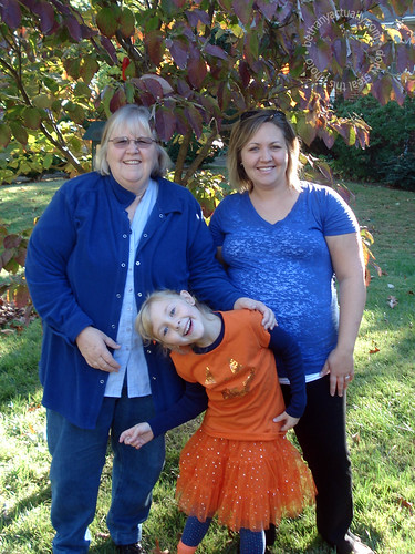 three generations in blue and orange