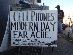 cell phones modern day ear ache, (anthonyturducken) Tags: signs sign louisiana hand painted neworleans handpainted signage centralcity vernacularsignage