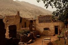 DSC_1101_tuyuguo_courtyard_flaming_mt (kdriese) Tags: china building muslim courtyard uighur xinjiang silkroad turpan taklamakan turfan nikond200 flamingmountain may2007 kendriese tuyuguo