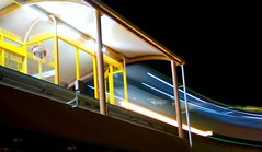 Monorail entering station (Erik K Veland) Tags: longexposure reflection art lights idea arty creative photowalk nightphoto monorail broadbeach