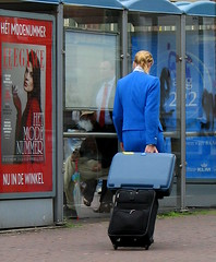 lady in blue (bogers) Tags: life street city blue people urban holland netherlands dutch poster photo waiting europe blauw foto you reclame diary nederland citylife tram denhaag haaglanden daily busstop bleu wait holanda klm stewardess bas thehague bogers stad wachten buiten haltestelle tramstop parada straat mensen ov zuidholland htm esperar abri airhostess tramhalte sgravenhage  haags hofstad straatfotografie haltestellen niederlnde basbogers octahobka airgirl 16082007 basbogersdenhaaghotmailcom straatfotografiecom