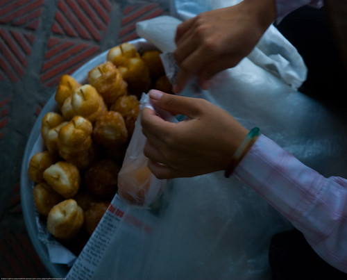 Woman selling doughnuts in Hanoi, Vietnam