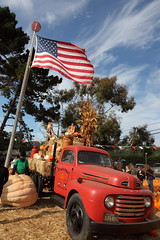 american tableau (1600 Squirrels) Tags: california usa ford truck pumpkin wagon photo milk lenstagged corn automobile flag scarecrow jug 1600squirrels sfbayarea nocal pumpkinpatch hay bale peninsula husk halfmoonbay radioflyer pumpkinfestival 2x3 sanmateocounty elgranada halfmoonbaypumpkinfestival canon24105f4 5dii halfmoonbaypumpkinfestival2010