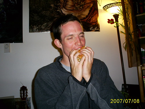 Adam eating the candy sandwich