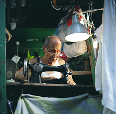 lifetime sewing (* tathei *) Tags: street city portrait people 120 6x6 film zeiss island hongkong candid sewing central cx hasselblad fujifilm medium format cf 503 tailor iso160 pro160s 80mmt