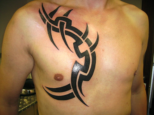 Tribal Tattoo modern piers in body