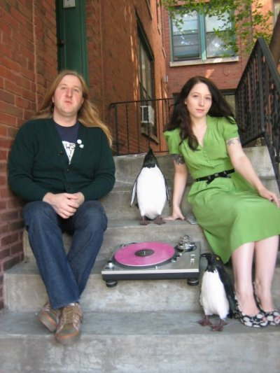 Rococo label heads - Joe and Nicole (and penguin)