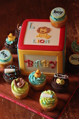 Building block cake with cuppies (Andrea's SweetCakes) Tags: wood boy cake cupcakes bottle buttons lion ducky rockinghorse babyshower safetypin baseballglove buildingblock